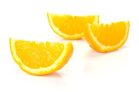oj: Orange quarters isolated against a white background