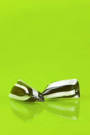 humbug: Humbug lollies isolated against a yellow background