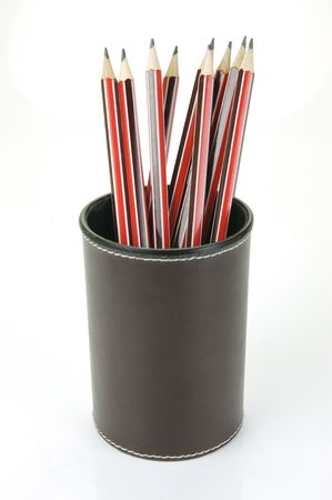 Lead pencils in a cup holder isolated against a white background Stock Photo - 4944434