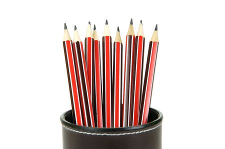 Lead pencils in a cup holder isolated against a white background photo