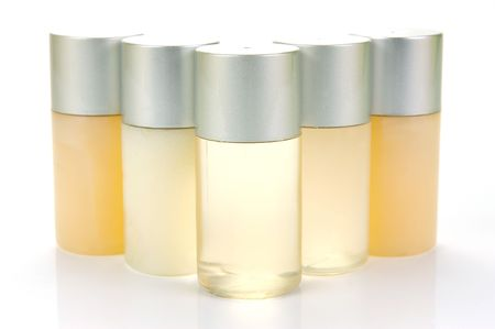Miniatureshampoo bottles isolated against a white background