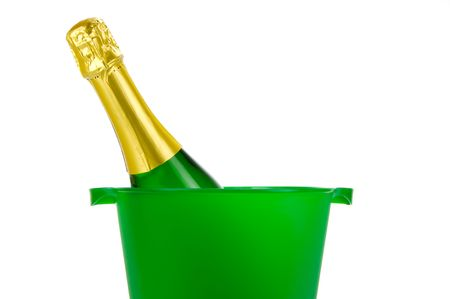 Bottles of sparkling wine in an ice bucket isolated agaisnt a white background photo
