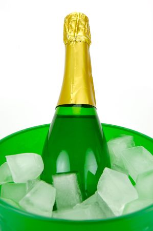 Bottles of sparkling wine in an ice bucket isolated agaisnt a white background Stock Photo - 5297776