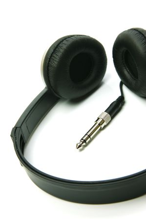 A pair of headphones isolated against a white background photo