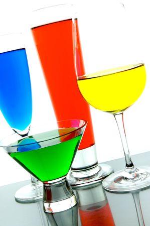 rainbow cocktail: Retroiluminada de c�cteles contra un fondo blanco Foto de archivo