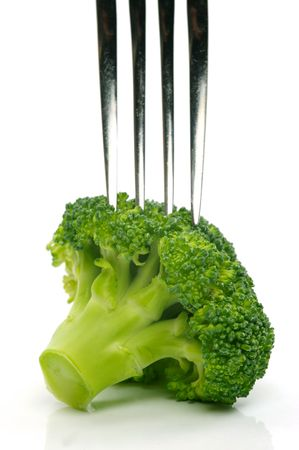A head broccoli isolated against a white background