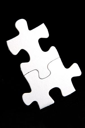 Jigsaw pieces isolated against a black background photo