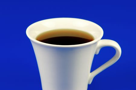 Black coffee isolated against a bluebackground photo