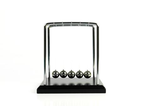 Newtons Cradle isolated against a white background photo