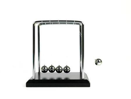 newton's cradle: Newtons Cradle isolated against a white background