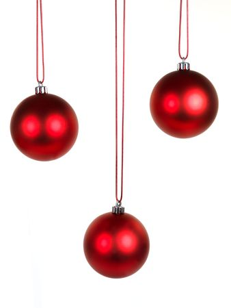 Hanging Christmas ornaments isolated against a white background Stock Photo