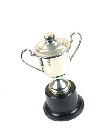 tarnished: An old tarnished trophy isolated against a white background