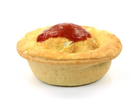 An Australian meat pie isolated against a white background