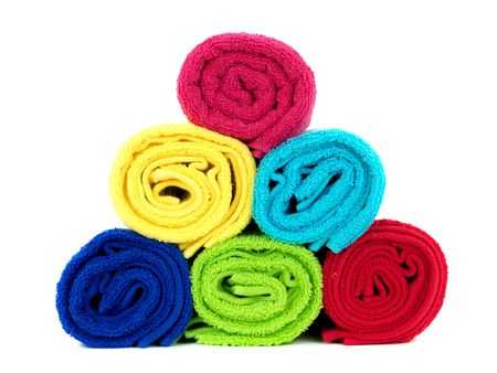 absorb: Colored bathroom towels isolated against a white background Stock Photo