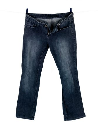 clothespegs: Jeans hanging from a clothes line isolated against a white background