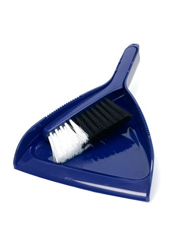 A dust pan and brush isolated against a white background photo