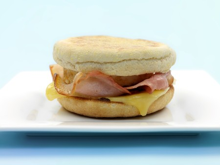 english breakfast: A breakfast bacon egg and cheese english muffin