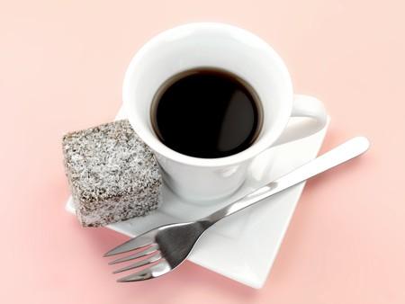 lamington: Small lamington cakes isolated against a pink background Stock Photo