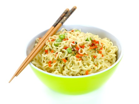 instant: Cooked instant noodles isolated against a white background