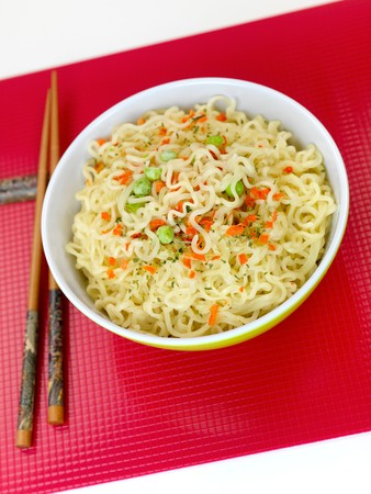 cooked instant noodle: Cooked instant noodles isolated against a white background