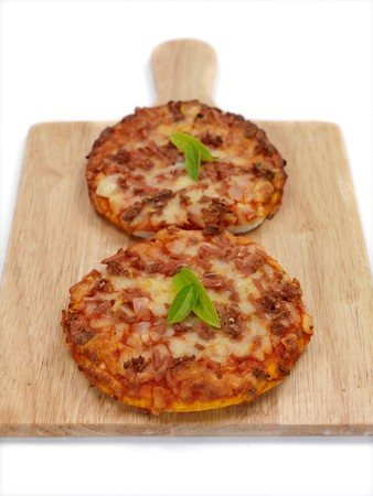 kitchen bench: Mini Pizzas isolated on a kitchen bench