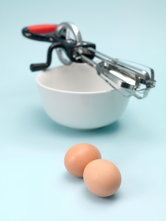 beater: An egg beater on a kitchen bench