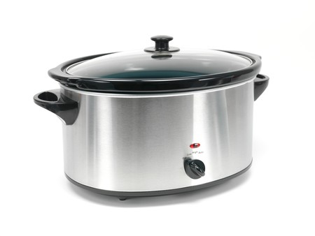 An electric slow cooker on a kitchen bench Standard-Bild