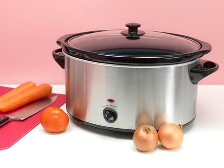 cookers: An electric slow cooker on a kitchen bench Stock Photo