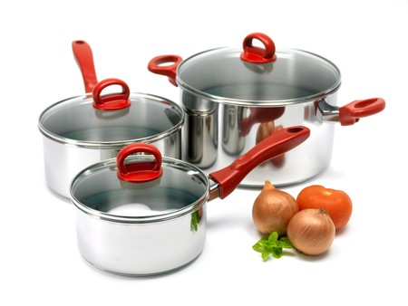 Silver cooking pots isolated against a white background