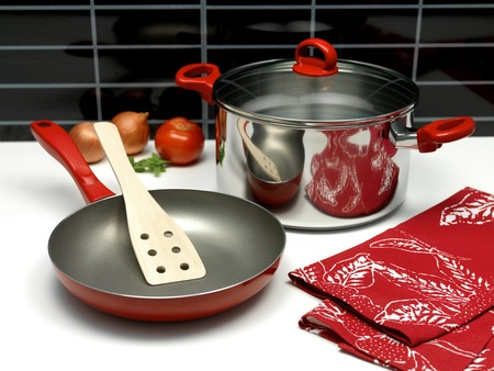 A saucepan and a frying pan on a kitchen bench