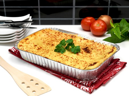 plating: A tray of lasagne ready for plating Stock Photo