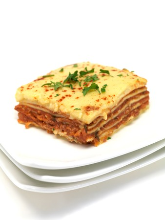 plated: Lasagne plated up and isolated against a white background