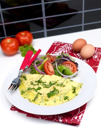 A freshley cooked herb omelette on a plate photo