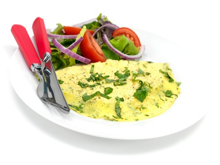 A freshley cooked herb omelette on a plate Stock Photo - 7342210
