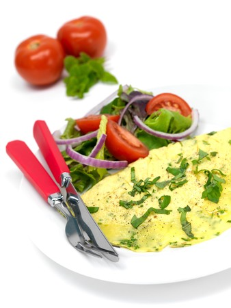 A freshley cooked herb omelette on a plate Stock Photo - 7342211