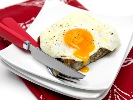 A freshly fried egg on a piece of toast Stock Photo - 7342218