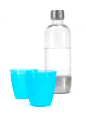 carbonated: Plastic cups filled with carbonated water isolated against a white background