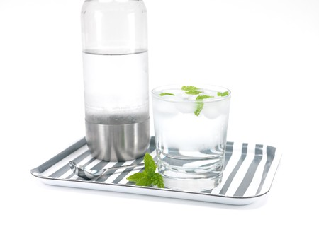 carbonated: Mint flavoured carbonated water on a serving tray isolated against a white background