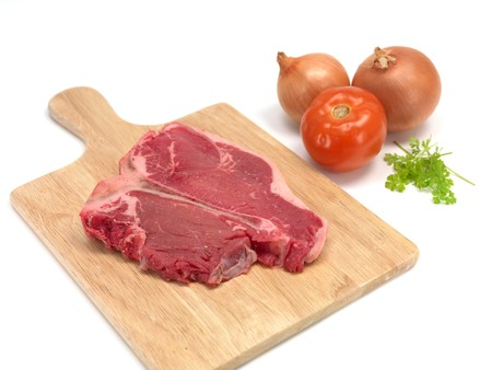 t bone: A T Bone steak isolated against a white background