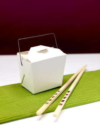 take away: Chop sticks and a takeaway box on a kitchen bench
