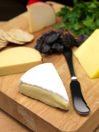 A selection of cheeses on a cutting board Archivio Fotografico