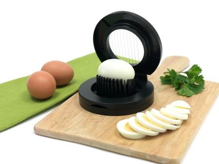 slicer: An egg slicer isolated against a white background Stock Photo