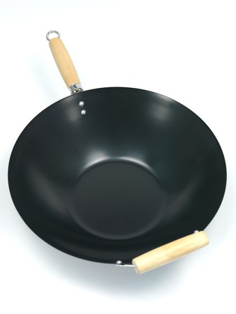 A wok isolated against a white background Stock Photo - 7462647
