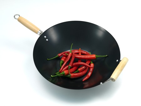 A wok isolated against a white background Stock Photo - 7462639