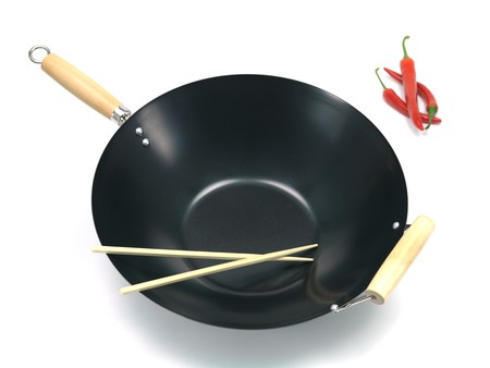 A wok isolated against a white background Stock Photo - 7462638