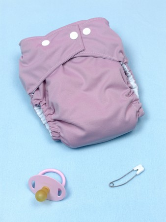 incontinence: A modern cloth nappy isolated against a blue background Stock Photo