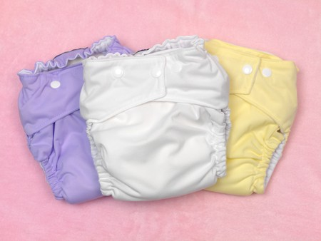 incontinence: A modern cloth nappy isolated against a pink background