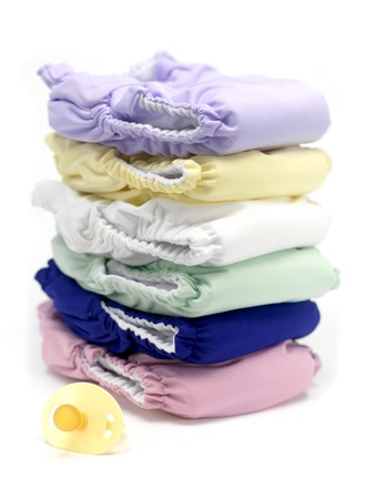 nappies: A stack of modern cloth nappies isolated against a white background