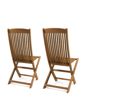 A deck chair isolated against a white background photo