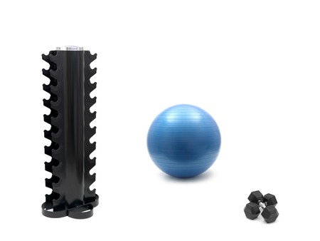 A fitball, dumbells and an empty dumbell rack isolated against a white background photo
